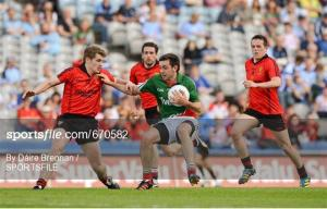 Kevin Mc Loughlin in action against Down