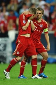 Phillip Lahm consoles Bastian Schweinsteiger after losing last year's Champions League final.