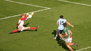David Clarke make a crucial save from Bernard Brogan.